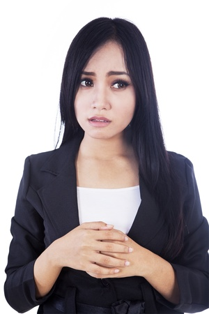 insecure: A businesswoman affraid of something isolated in white Stock Photo