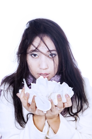 Asian girl is holding bunch of tissues due to flu, isolated in white photo