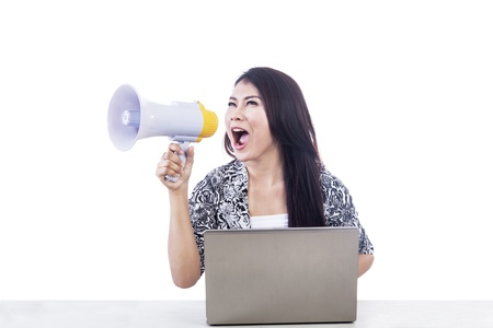 Beautiful Asian woman announce something using a speaker and laptop isolated over white Stock Photo - 16634106