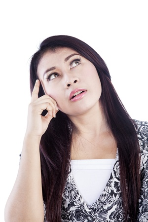 Portrait of a young business woman in brainstorming gesture isolated over white background photo