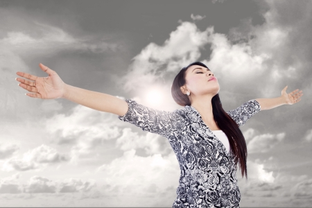 Businesswoman is stretching her arms expressing her winning outdoor Stock Photo - 16634142
