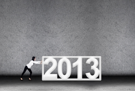 A concept of businesswoman effort in 2013 for new year Stock Photo - 16634514