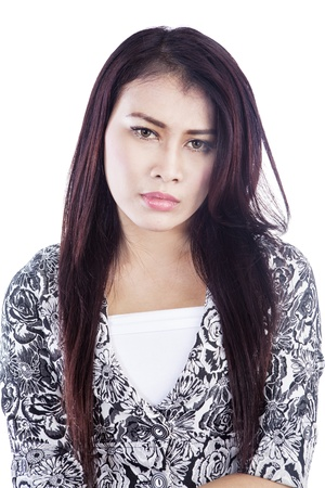 Portrait of young woman with depressed face isolated over white background photo