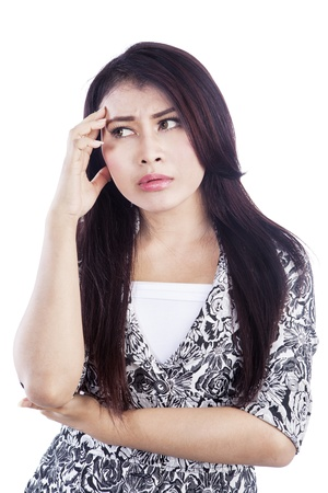 Portrait of a thinking young woman isolated against white background