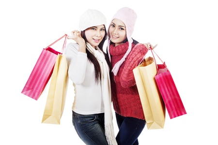 Two friends holding shopping bags in pink and brown, isolated in white photo