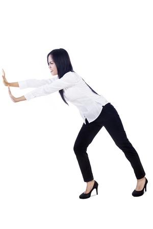 Businesswoman is pushing something on copyspace Stock Photo - 16660514