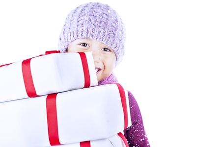 A boy carry holiday gifts, isolated in white photo