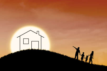 Silhouette of family dream house on orange sunset background photo