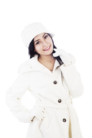 Portrait of fashionable young woman wearing winter clothes  isolated on white Stock Photo - 16660515
