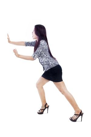something: A woman is pushing something on copyspace