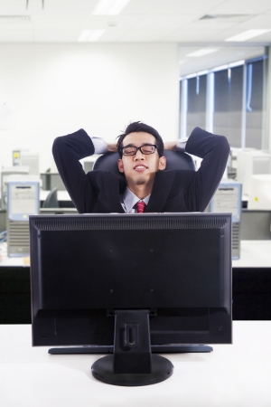 catnap: Businessman relax in front of computer at office Stock Photo