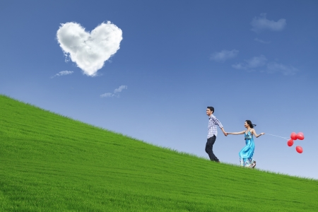 Enjoying Valentine day together in park Stock Photo