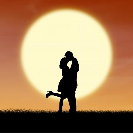 enamorados besandose: Silueta de la pareja besándose en la puesta del sol durante el día de San Valentín