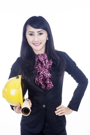 Beautiful woman architect is holding a helmet and a plan isolated over white photo