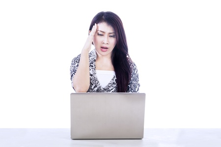 Picture of beautiful woman stress out while working with her laptop photo