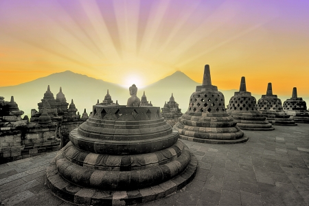 Borobudur temple at sunrise with mountain overview photo