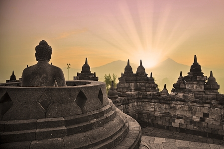 Sunrise at Borobudur temple and buddha statue photo