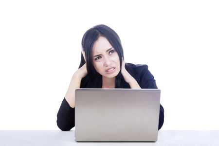 fear woman: Beautiful businesswoman stress out with her laptop isolated over white