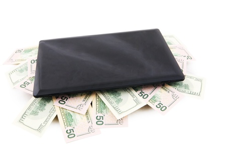 Picture of computer laptop and 50 US dollars inside it, symbolising earning money via online photo