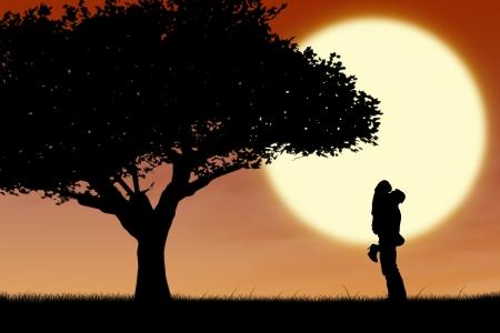 couple lit: couple hugging near a tree on orange silhouette sunset Stock Photo