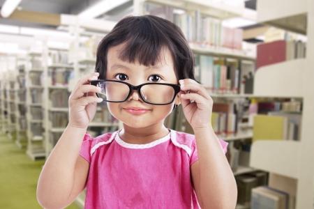 A cute girl is wearing glasses in school photo