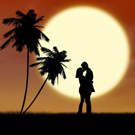 Young couple is kissing near palm trees by sunset on the beach photo