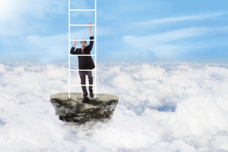 Businessman is climbing white stairs above the clouds photo