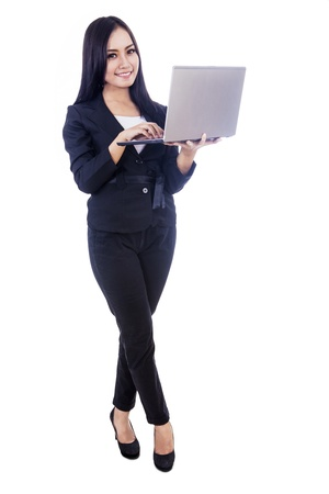 Young businesswoman with laptop isolated on white Stock Photo - 17249621