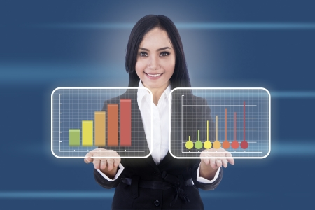 Beautiful businesswoman shows two virtual diagrams with upward movement Stock Photo - 17249664