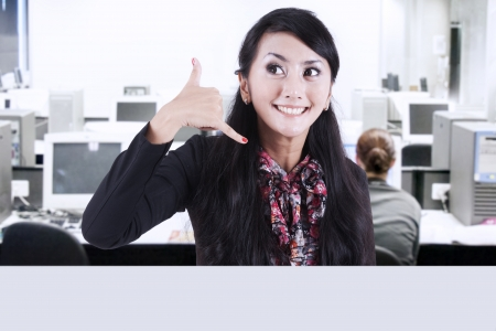 Businesswoman gestures of the phone Stock Photo - 17249653