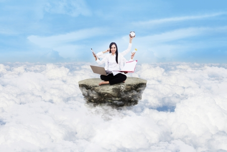 Young entrepreneur is doing multitasking above the clouds photo