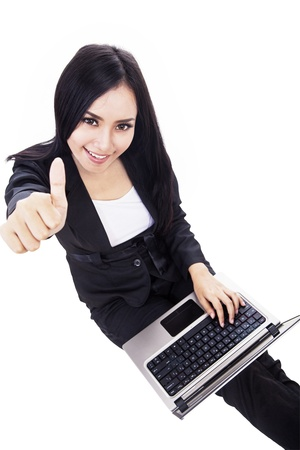 computer model: Happy woman is giving thumbs up success sign with excited face expression.