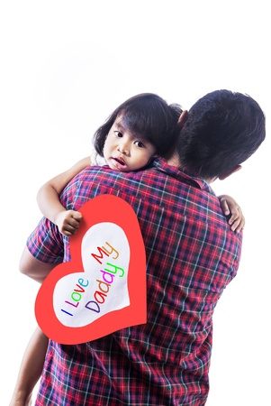 indonesian people: Cute girl is holding a love card , while being carried by her dad