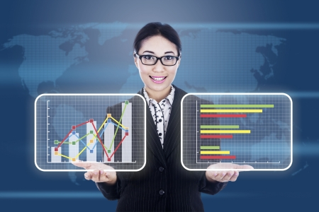 Portrait of asian businesswoman showing business chart on a graphic interface Stock Photo - 17249657