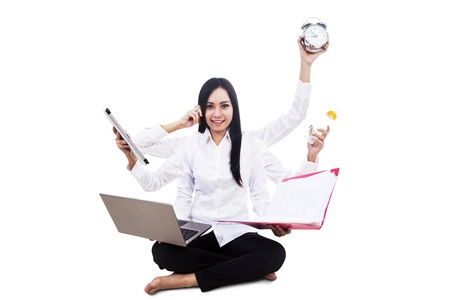 Young businesswoman multitasking isolated on white photo