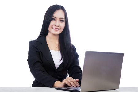 Young businesswoman smiling at camera, isolated over white Stock Photo - 17382383
