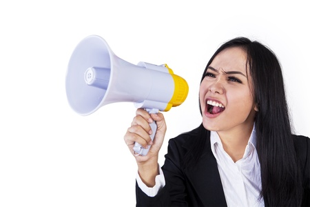 woman shouting: Business woman with megaphone yelling and screaming isolated on white background Stock Photo