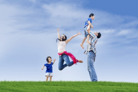 family asia: Family members including parents and two children are having fun at the park Stock Photo