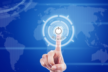 Human finger is touching a futuristic button on global digital touch screen Stock Photo - 17573296