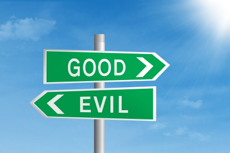 Green road sign of good vs evil under blue sky Stock Photo - 17573274