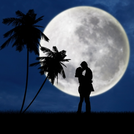 Silhouette of a young couple kissing under blue full moon at the beach photo