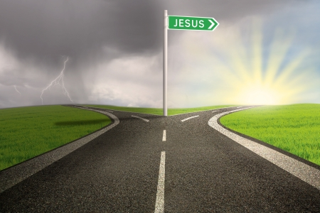 Highway with green road sign of Jesus name on stormy background Reklamní fotografie