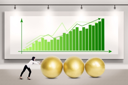 Businesswoman pushing three golden eggs on bar chart background Stock Photo - 17533503