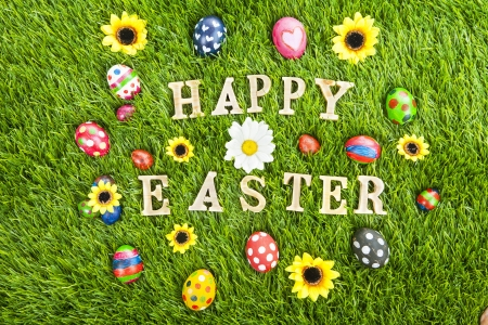 Easter eggs and Happy Easter greeting on the grass  photo