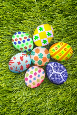 Colorful easter eggs laying on the grass  photo