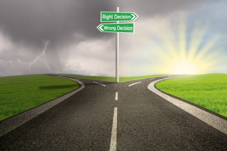 crossroads: Green road sign of right vs wrong decision on highway with thunder storm background