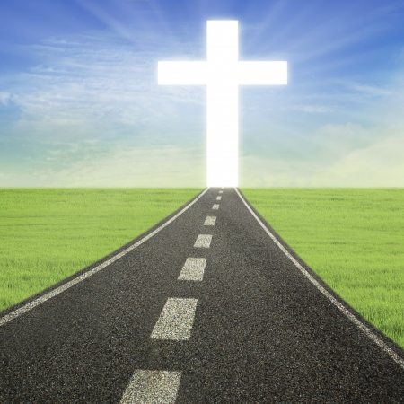 end of road: Bright Cross is at the end of the road Stock Photo