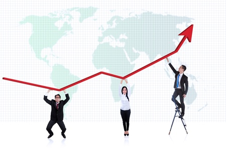 happy business team: Picture of line chart with business people underneath it in front of world map background