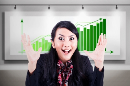 Successful businesswoman excited to see significant increase in earnings Stock Photo - 17824198