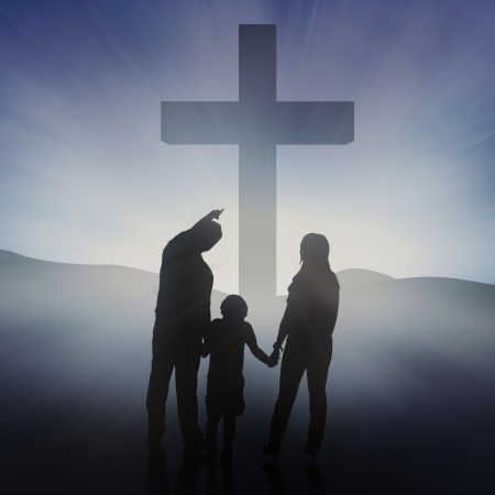 Silhouette of Christian family at the Cross on blue background photo